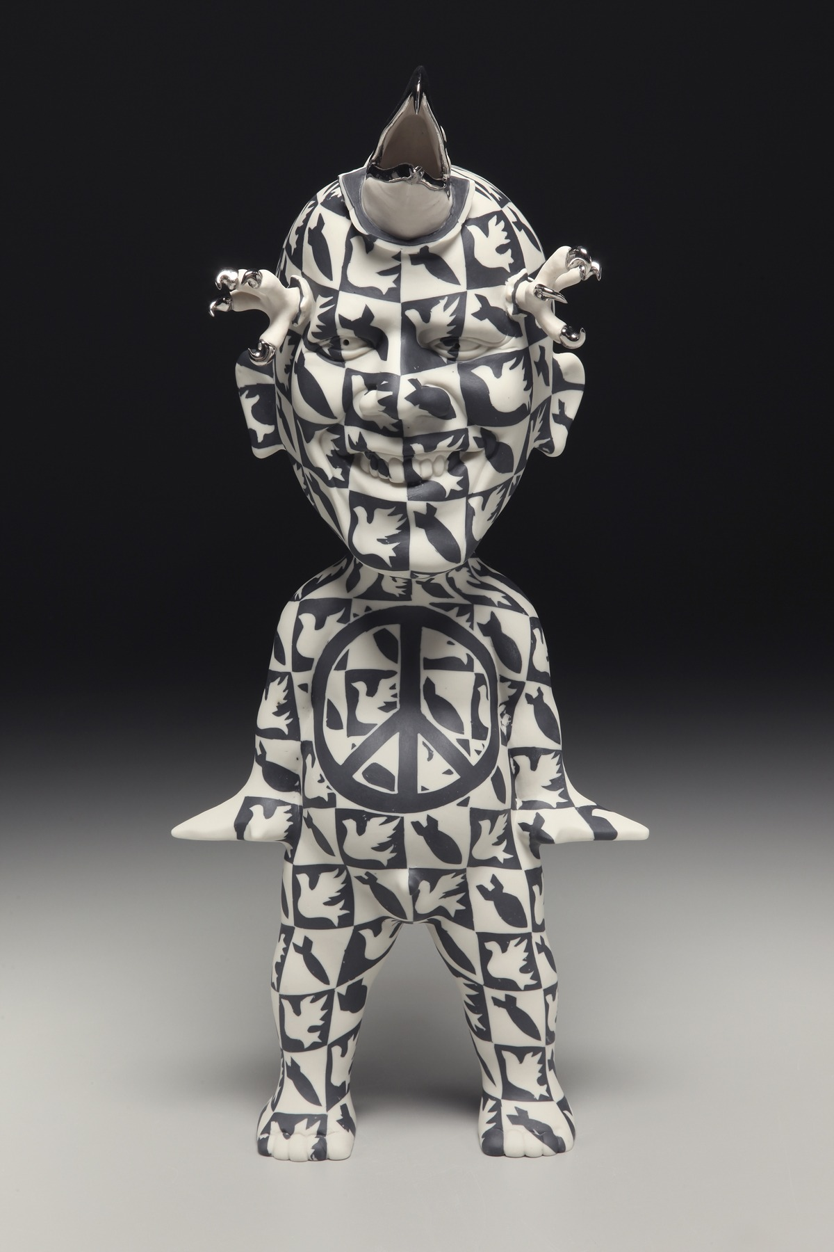 """RUSSELL BILES; """"Decision Maker""""; 2010; slipcast/inlayed porcelain; h17""""; photo Tim Barnwell."""