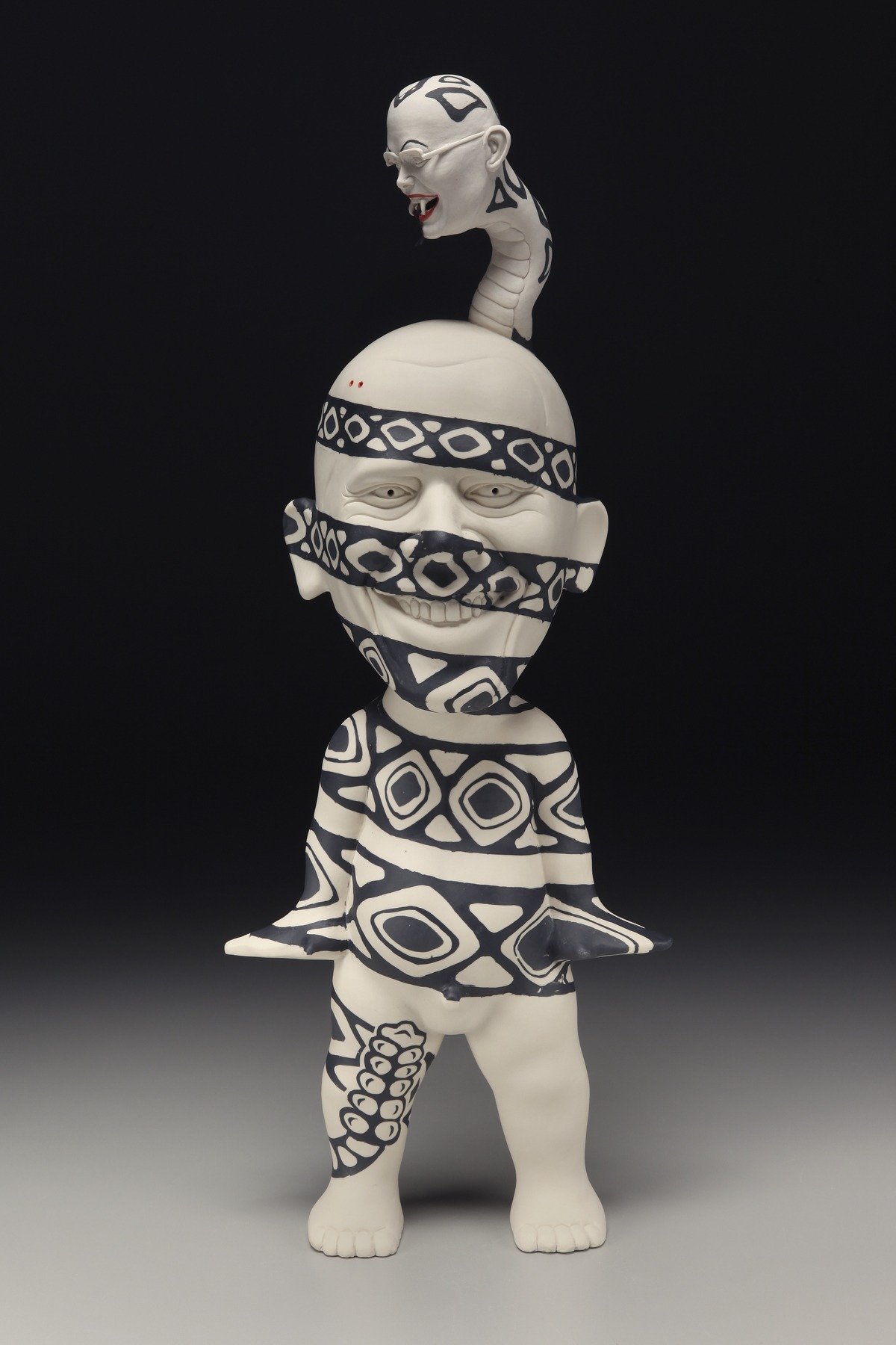 "RUSSELL BILES; ""Potentially Fatal""; 2011; slipcast/handbuilt/inlay porcelain; h19""; photo Tim Barnwell."