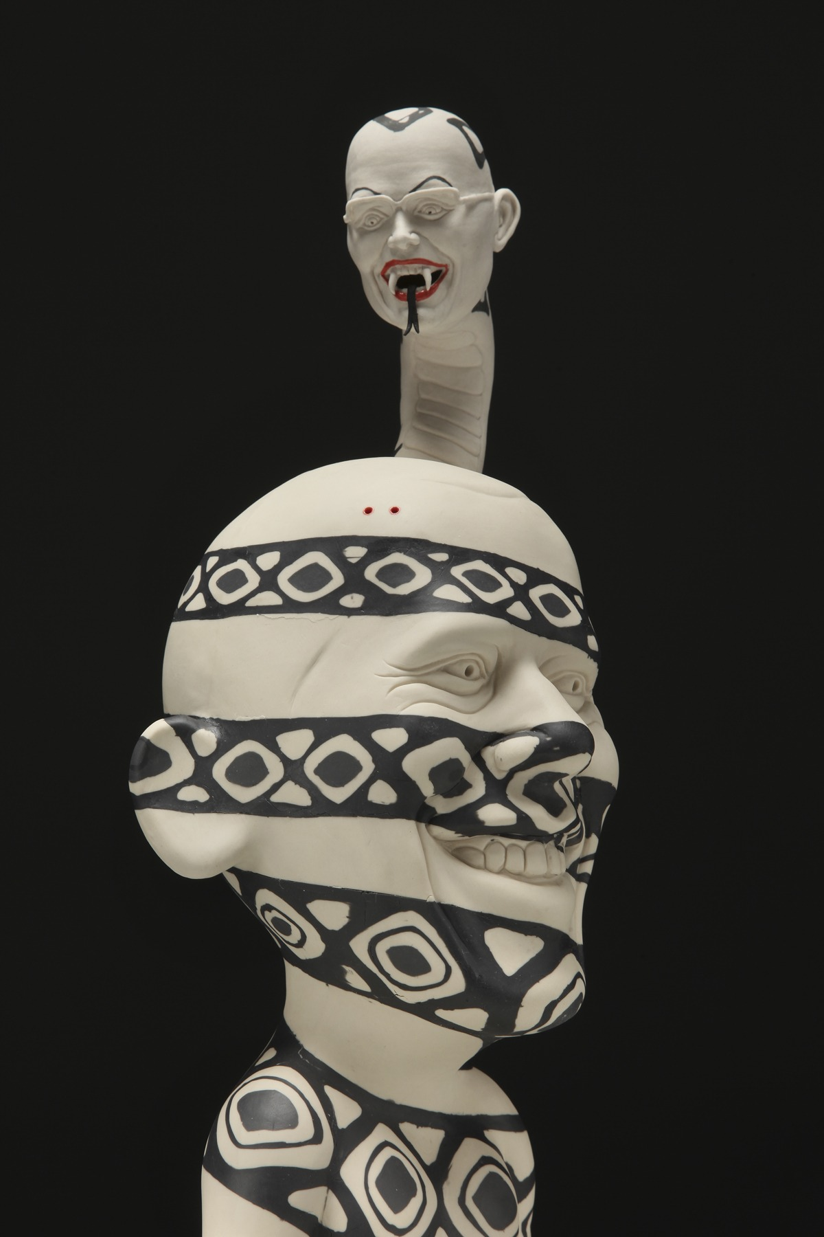 "RUSSELL BILES; ""Potentially Fatal""; 2011; slipcast/handbuilt/inlay porcelain; h19""; photo Tim Barnwell."