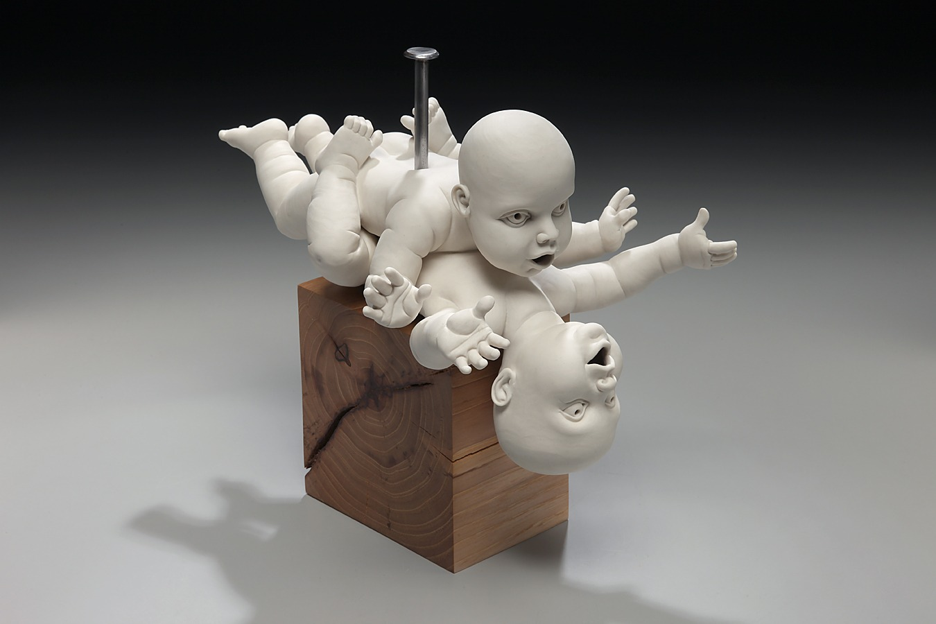"RUSSELL BILES;""Nailed (Babies Making Babies)""; 2010; hand built porcelain, wood;h8""; photo Tim Barnwell."