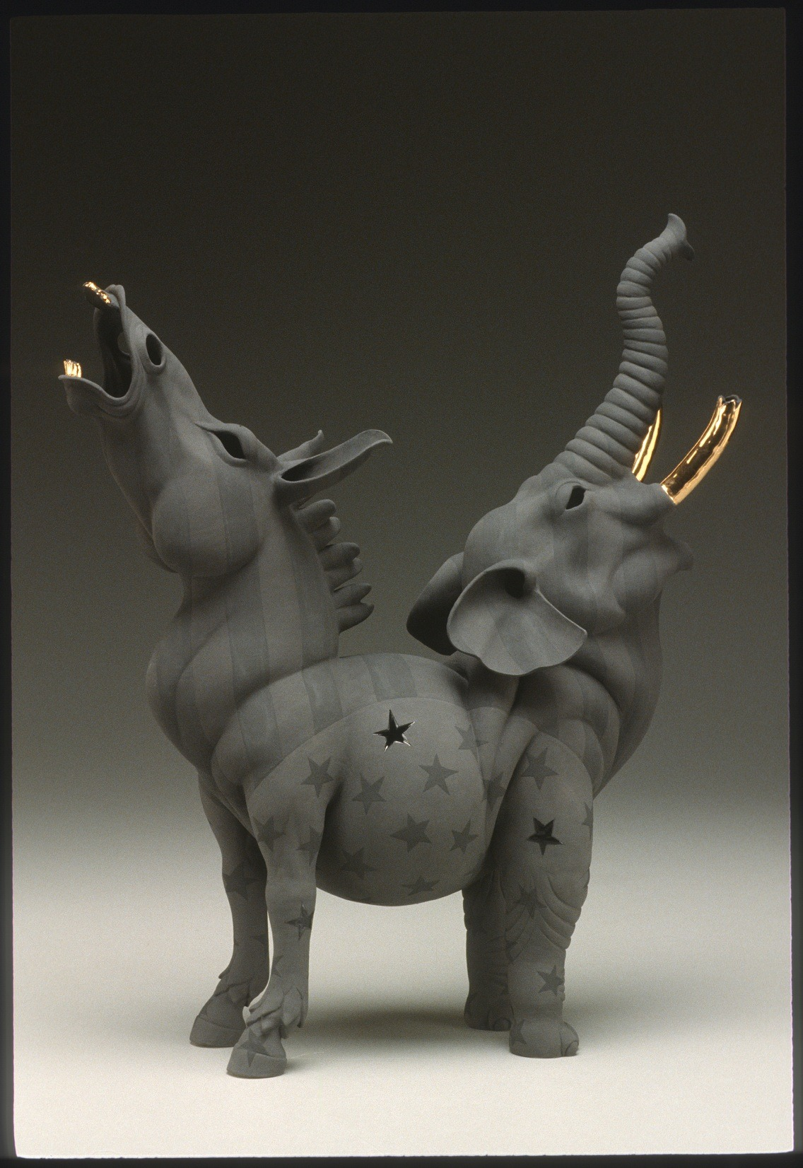 "RUSSELL BILES;""Screw Me Screw You""; 2003; hand built porcelain; h20""; photo Tim Barnwell."